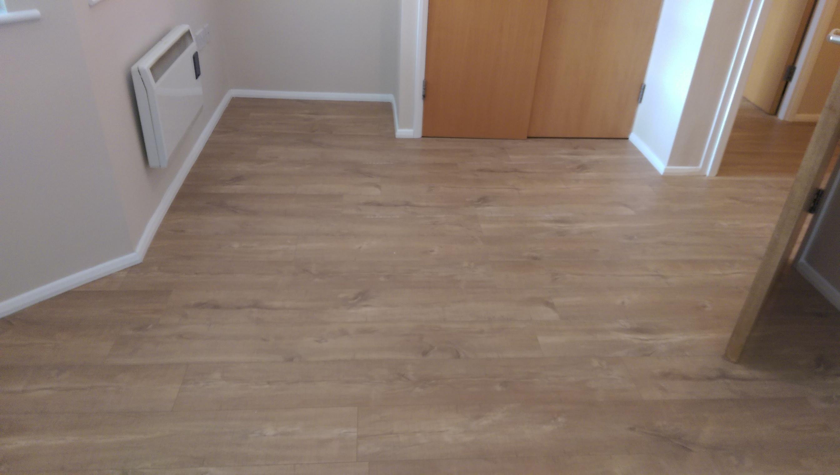 Jjp wood flooring company home for Laminate wood flooring installation companies