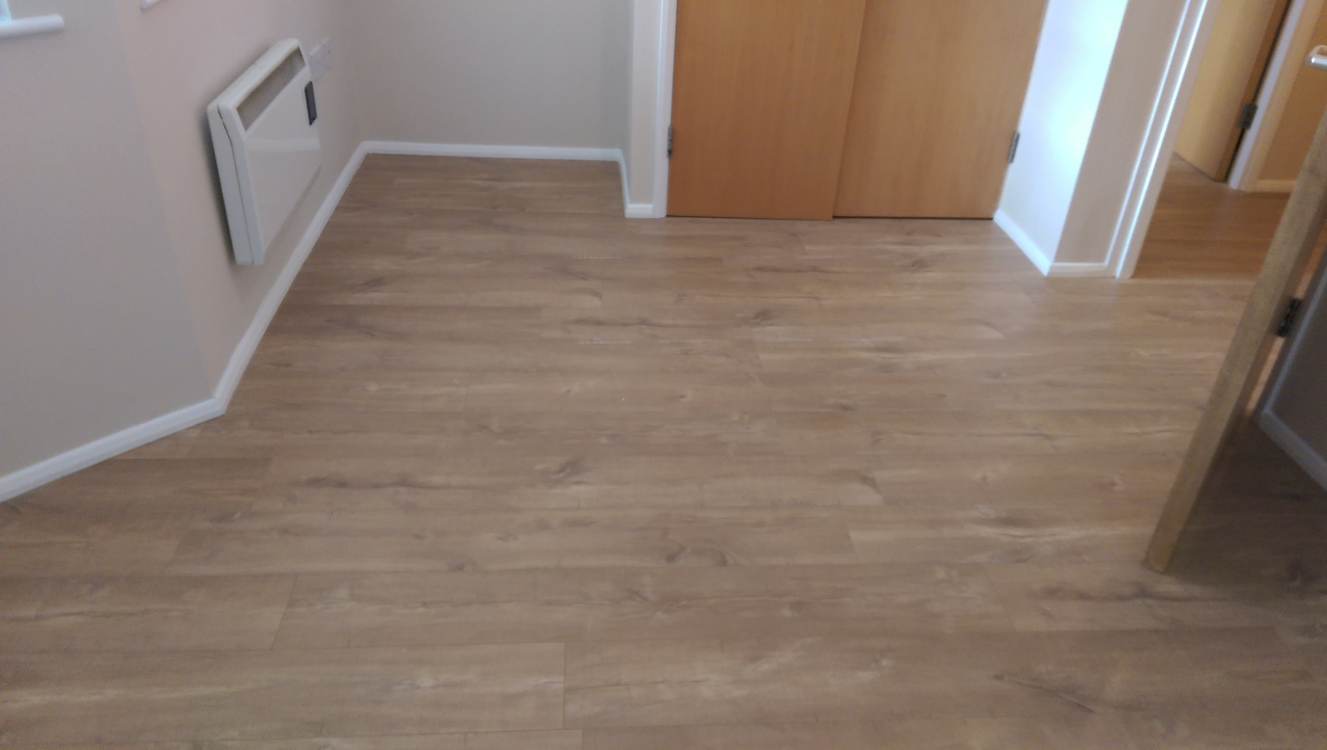 Quick step flooring installation gurus floor for Laminate flooring enfield